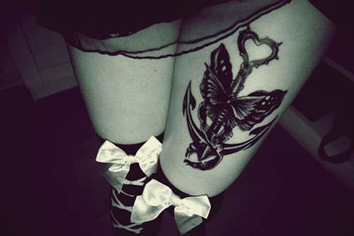 kadın üst bacak çapa ve kelebek dövmesi kadın üst bacak anchor and butterfly tattoo
