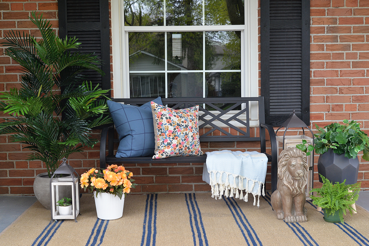 front porch decorated with artificial outdoor plants