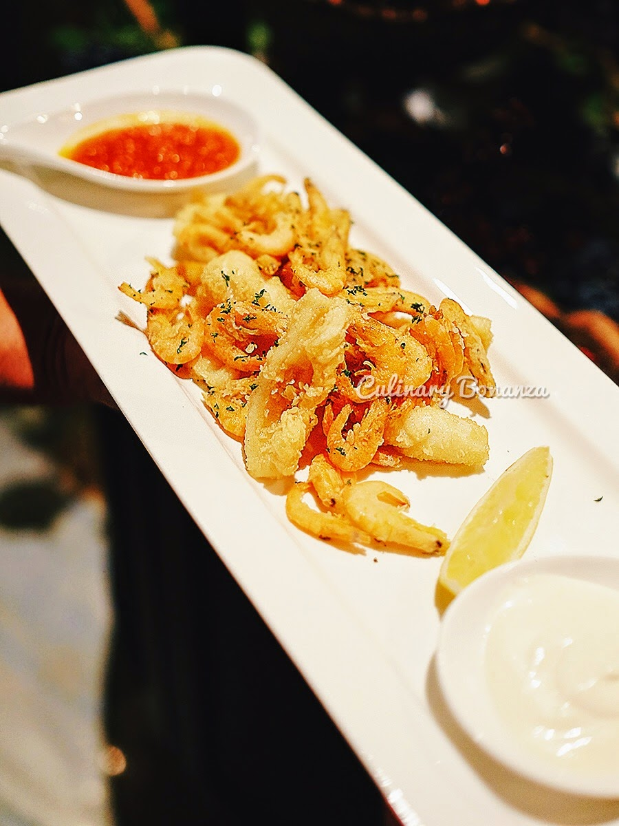 Calamari Fritti - deep fried squid and baby prawns served with spicy Arrabiata sauce.