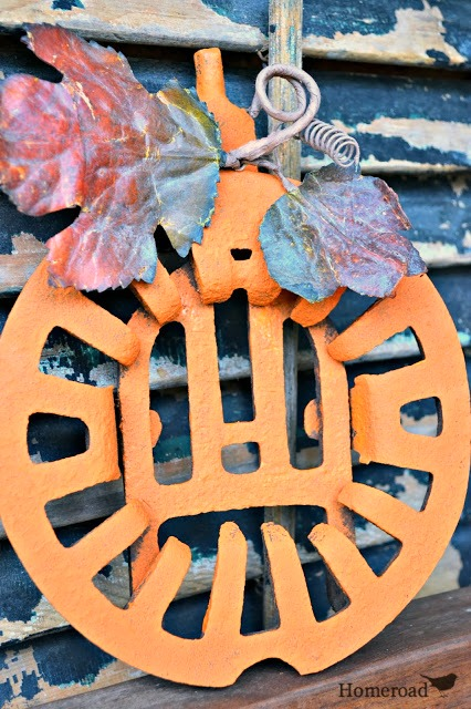 rustic grate pumpkin with leaves and tendril