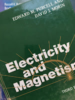 Electricity and Magnetism, 3rd Edition, by Edward Purcell and David Morin, superimposed on Intermediate Physics for Medicine and Biology.