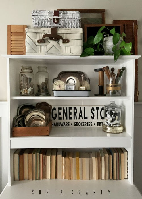 White Cupboard displaying vintage collections.