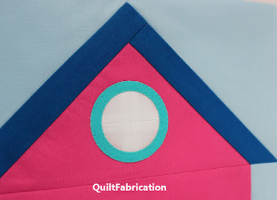round window on a house quilt block