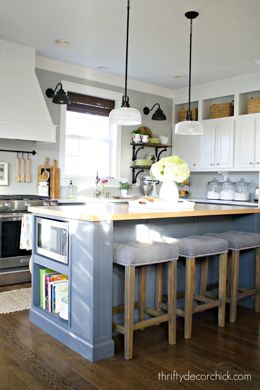 dark gray island white cabinets