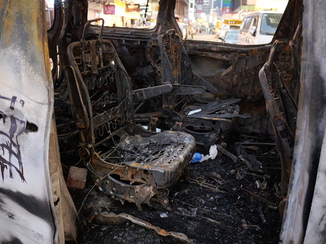 inside of heavily damage burned vehicle in Mong Kok