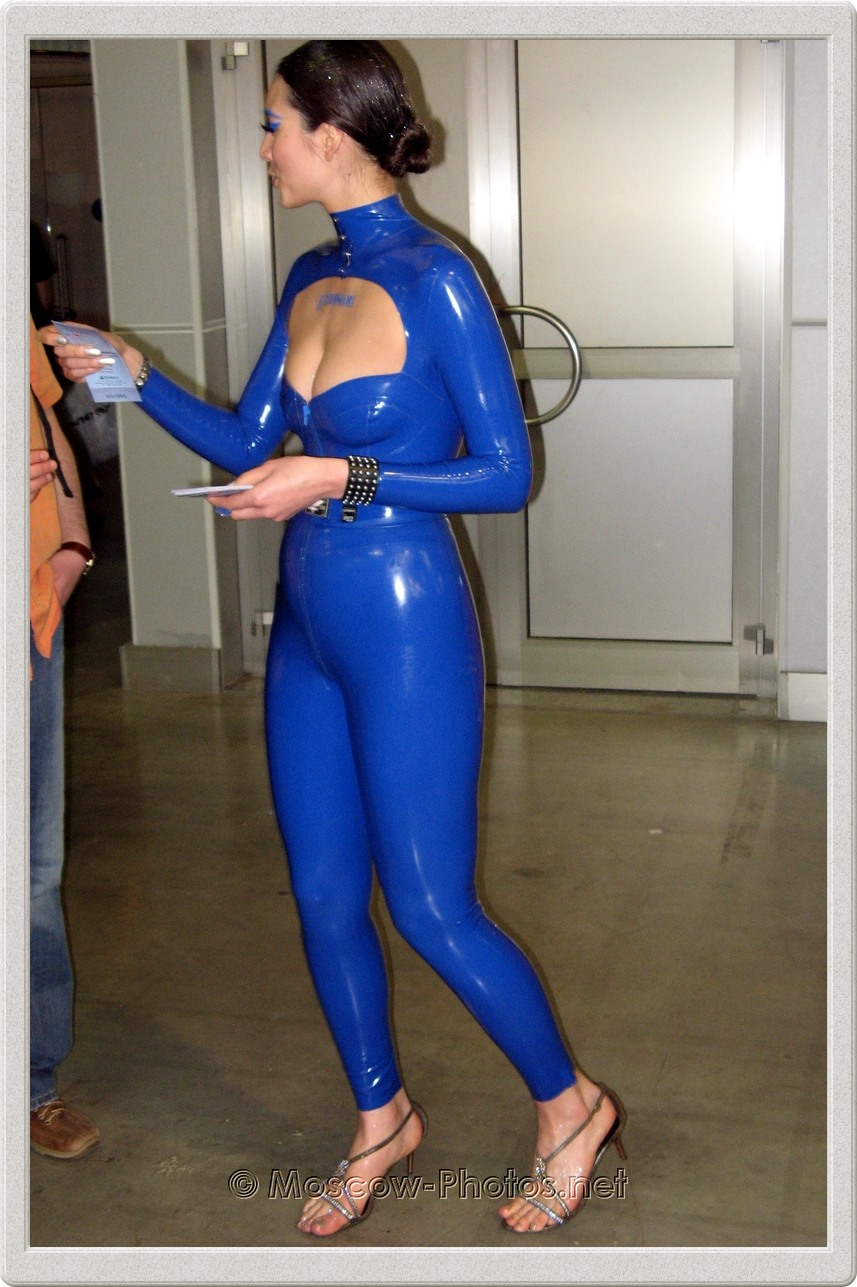 Promotional model in blue rubber suit