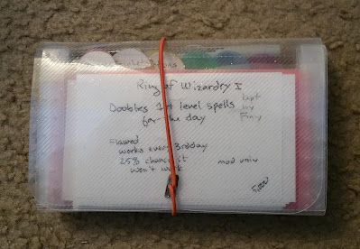 3 x 5 notecard organizer filled with notecards and a fine tip black Sharpie