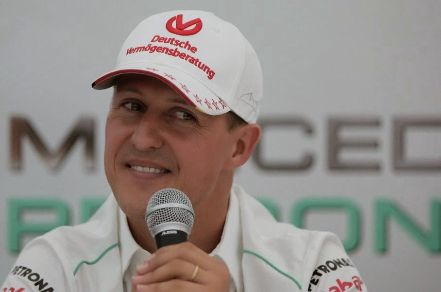 "In this Thursday, Oct. 4, 2012 file photo, Michael Schumacher announces his retirement from Formula One at the end of the 2012 season during a press conference at the Suzuka Circuit venue for the Japanese Formula One Grand Prix in Suzuka, Japan. Schumacher's manager says the Formula One great is no longer in a coma and has left a French hospital where he had been receiving treatment since a skiing accident in December. Manager Sabine Kehm says in a statement Monday, June 16, 2014, that Schumacher has left the hospital in Grenoble ""to continue his long phase of rehabilitation."" The statement did not say where the seven-time F1 champion was taken or give any details of his condition."
