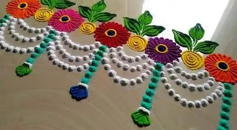 border rangoli made up of flowers and leave