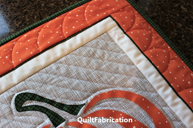 flange insert in border on Pumpkin applique table runner