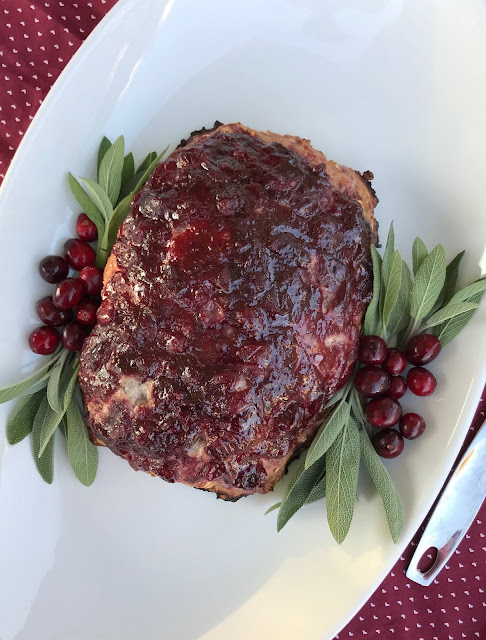 Turkey meatloaf is glazed with a sweet and tangy sauce of brown sugar and fresh cranberries for a delicious autumn dinner.