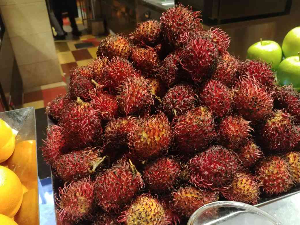Fresh rambutan at the dessert station of The Grand Kitchen
