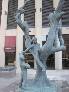 Tree Children sculpture Portage & Main.