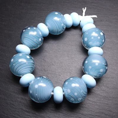Lampwork glass gravity swirl beads by Laura Sparling