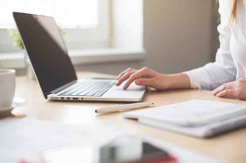 Women using White Laptop
