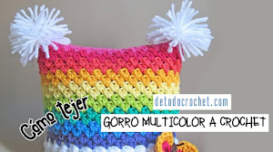 Gorro con pompones a crochet