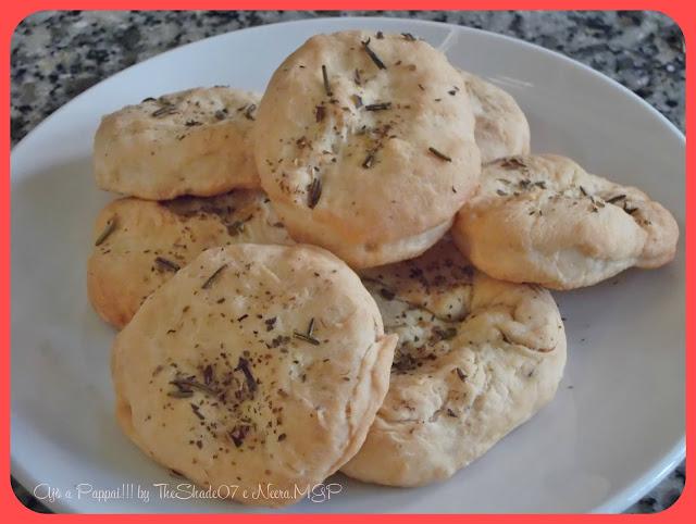 Fotografia della ricetta Is panineddusu cun spiccu e origanu
