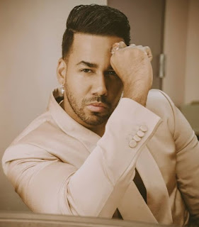 Romeo Santos posing for a picture