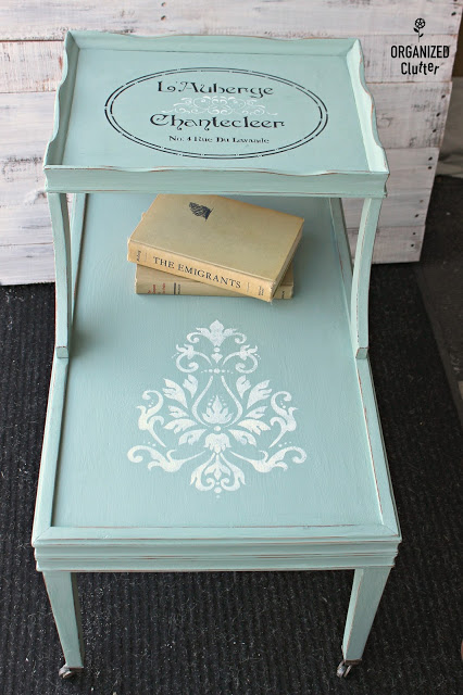 Photo of a mid century end table in duck egg blue with stencils
