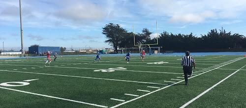 EC receiver Ian Dugas running away from SSF defenders.