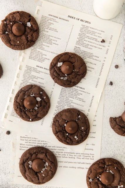 cookies sitting on top of cookbook pages.