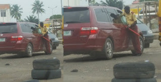LOL; LASTMA Officer plead for mercy after his hand was locked by driver when he tried to forcefully enter a car (PHOTO)