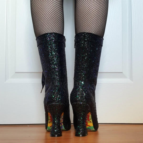 black glitter calf boots worn with fishnet tights