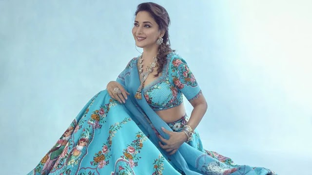 Madhuri Dixit and her fascination for lehengas and sarees in the blue waala shade. See pics