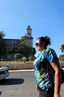 Woman walking by old church in Puriscal