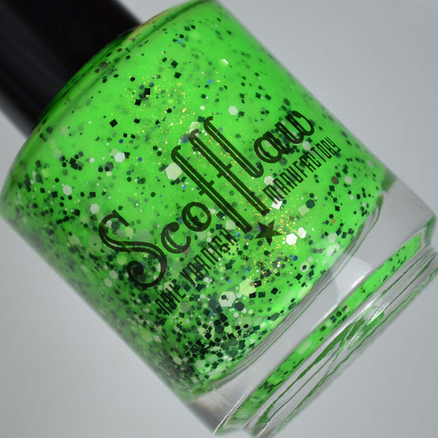 neon green nail polish with glitter in a bottle