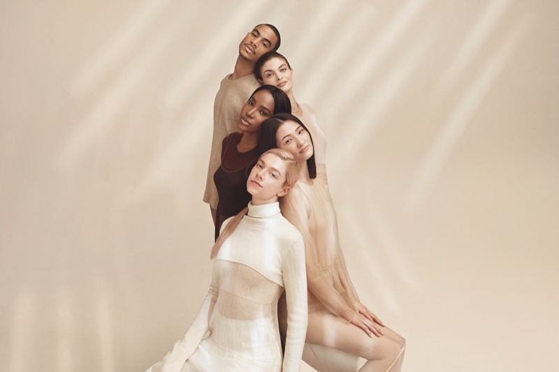 Actress Hunter Schafer poses with others in Synchro Skin Radiant Lifting Foundation campaign.