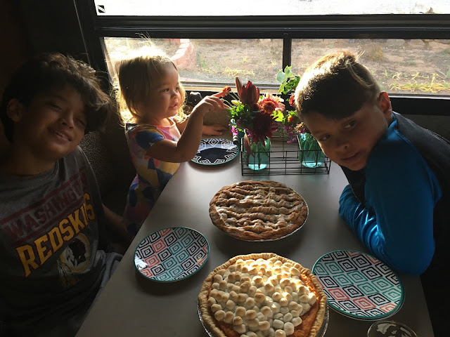 Kids with sweet potato and cinnamon bun apple pies