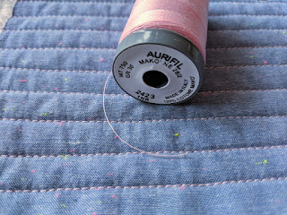 Machine quilted lines and Aurifil thread