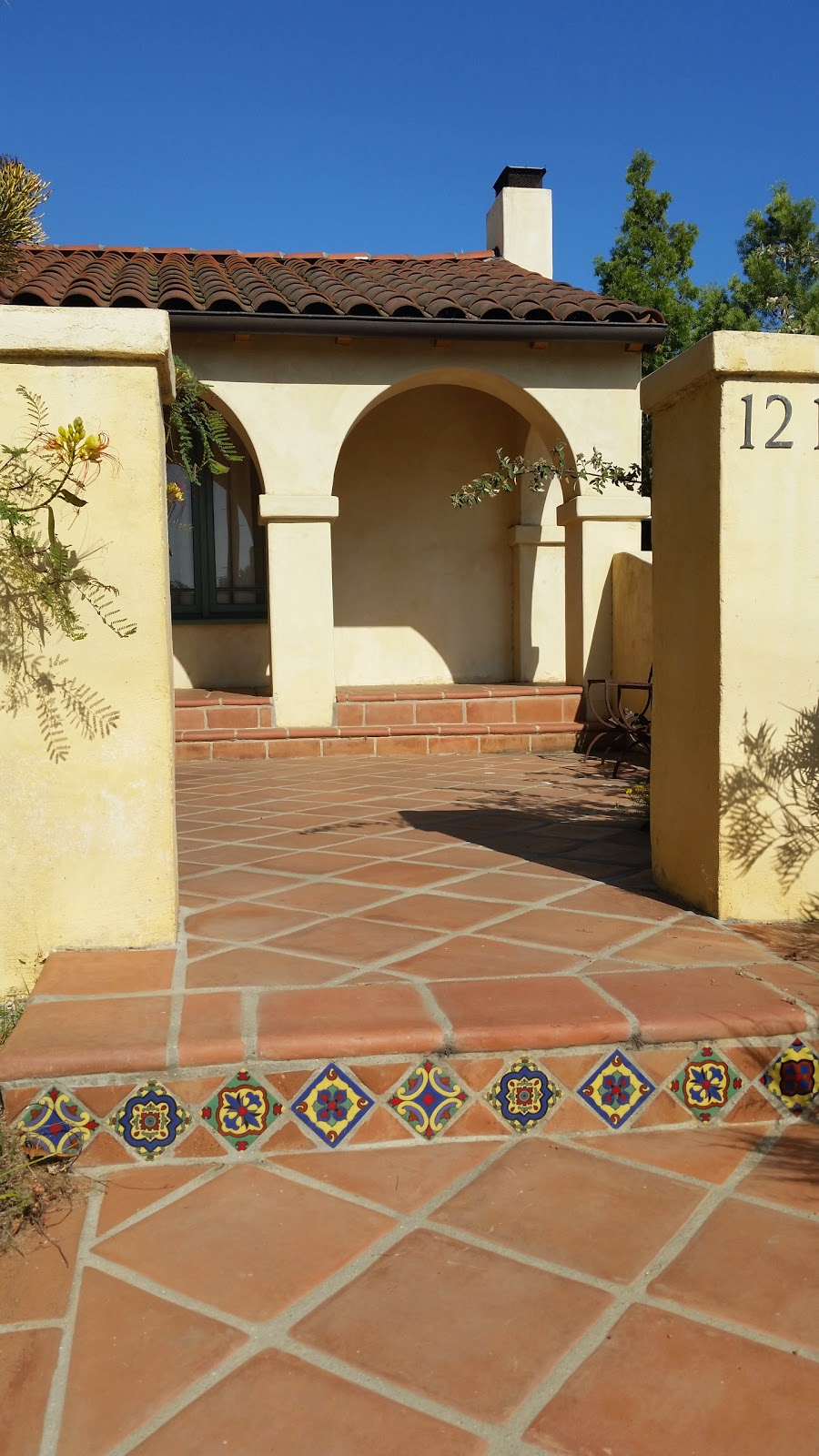Both pavers and decorative riser tiles are on point in this open courtyard.