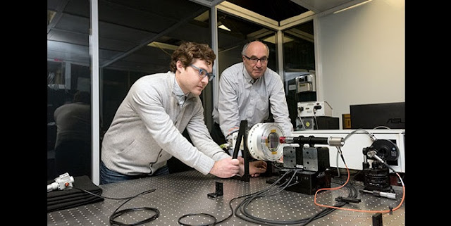 RIT professor Zoran Ninkov, right, and Dmitry Vorobiev '17 (astrophysical sciences and technology), a postdoctoral researcher in RIT's Chester F. Carlson Center for Imaging Science, work on a new astronomical imaging system using technology found in Texas Instruments' digital cinema projectors. Credit: A. Sue Weisler