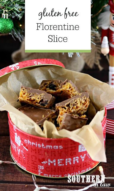 Gluten Free Florentine Slice pieces in a red Christmas tin for a homemade Christmas gift