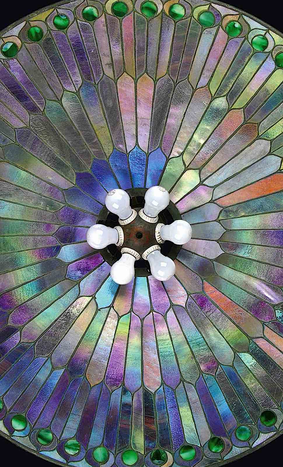 a giant Tiffany ceiling lamp 1920s? in a raiating design with rainbow colors