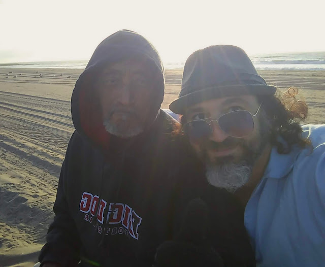 Lonny Jones being welcomed by Omar Cherif on his first time to Full Lunacy Drum Circle at Dockweiler Beach — 30 April 2018