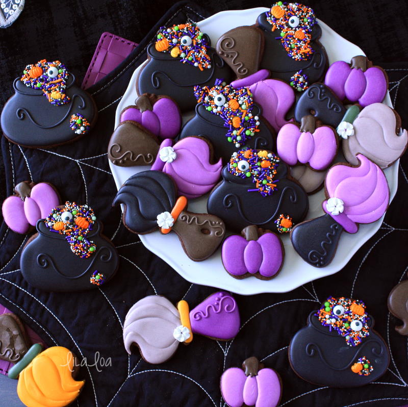Witch broom and sprinkle cauldron decorated chocolate sugar cookies
