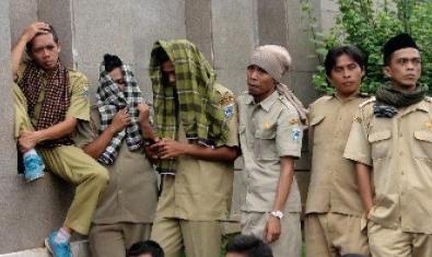 Jokowi Resmi PHK 1,37 Juta PNS Lulusan SMA Se Indonesia
