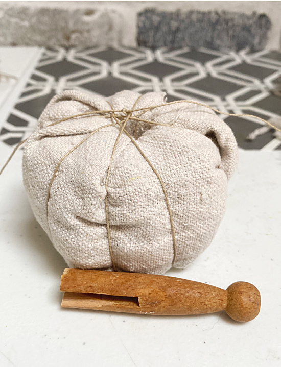 wrapped pumpkin and clothespin