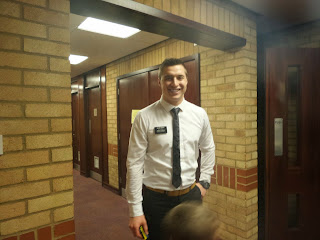 A Missionary from The Church of Jesus Christ of Latter Day Saints greeting members at Church