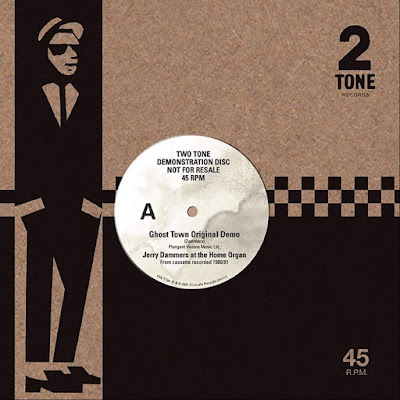 The cover features the paper label with the title; and the sleeve features Walt Jabsco, an illustration of a rude boy in a sunglasses, suit, tie, loafers, and trilby.