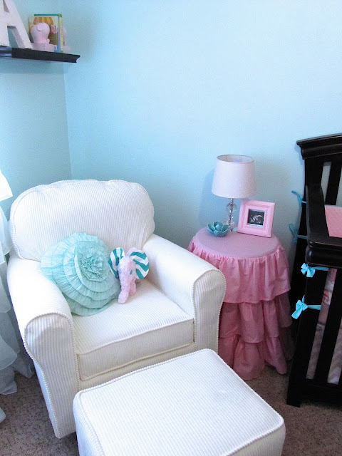pink ruffle table cover for nursery