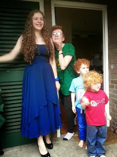 Four children aged 4, 5, teenage and 16 year old Elspeth ready for prom