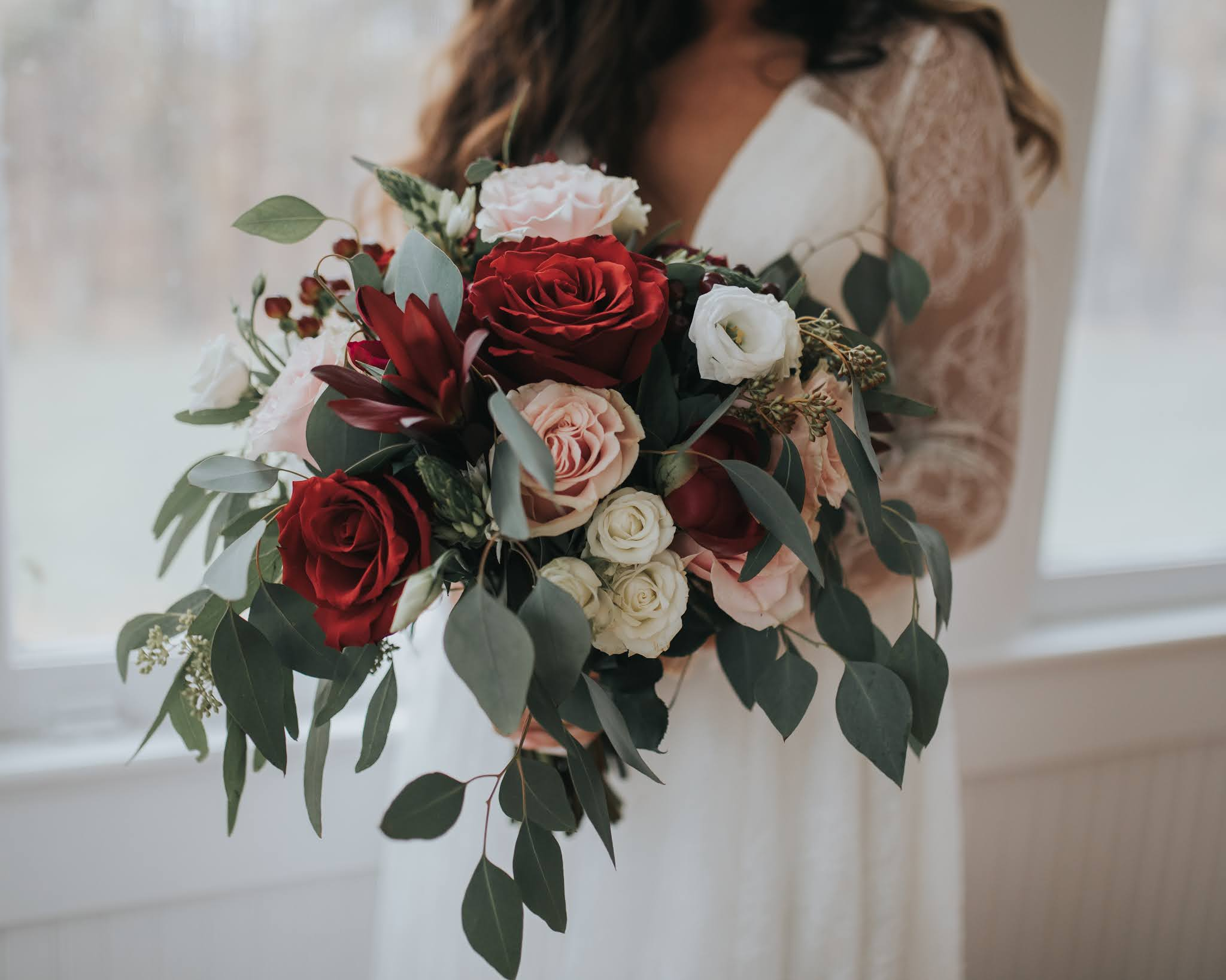 bridal bouquet with roses, eucalyptus, Christmas wedding photography