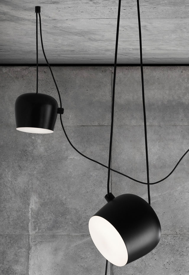 The flos aim pendant light features a varnished aluminum body and a photo etched optical polycarbonate diffuser the directional body houses a photo etched