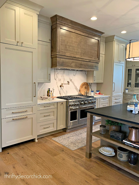 light taupe kitchen cabinets wood island vent hood