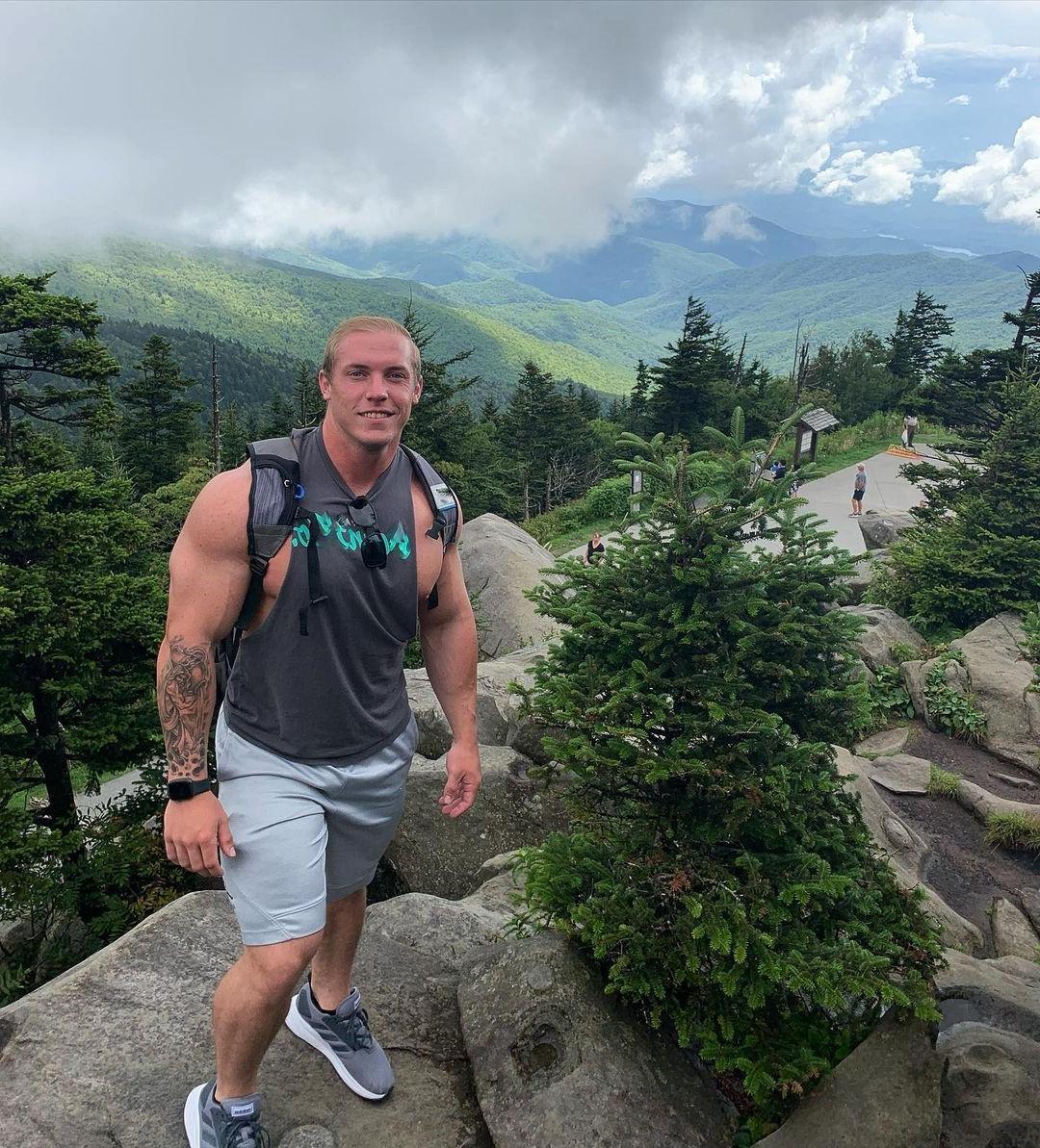huge-muscular-blond-hunk-tyler-oberholtzer-mountain-climbing-male-nip-slip-arm-tattoo-beefcake