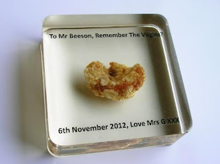 Custom made paperweight containing a pork scratching